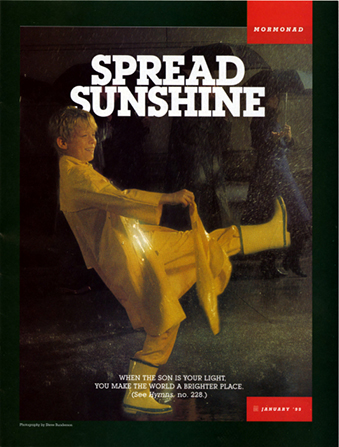 "A conceptual photograph of a boy in a yellow raincoat and rain boots dancing on a rainy street, paired with the words ""Spread Sunshine."""