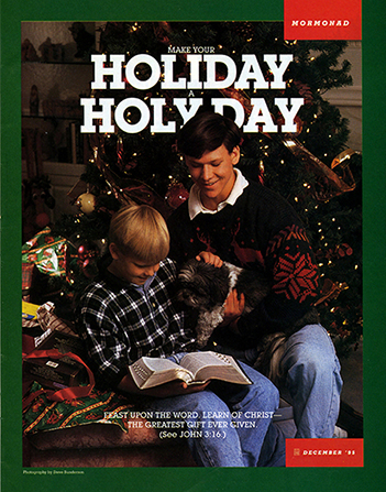 "A photograph of two brothers sitting near a Christmas tree reading the scriptures, paired with the words ""Make Your Holiday a Holy Day."""