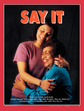 "An image of a young woman hugging her mother, paired with the words ""Say It."""