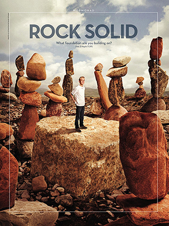 """A conceptual photograph showing a young man standing on a large rock surrounded by stacks of boulders, paired with the words """"Rock Solid."""""""