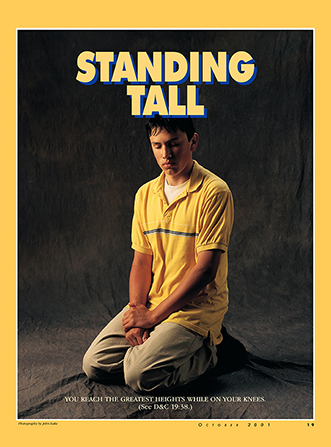 "A poster of a young man praying, paired with the words ""Standing Tall."""