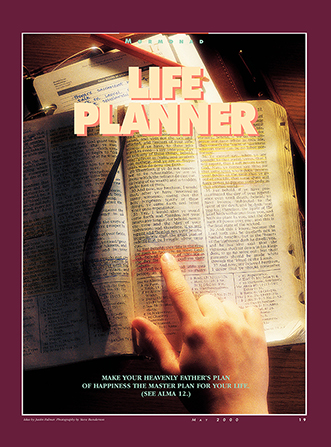 "A conceptual photograph of a set of scriptures open next to a day planner, paired with the words ""Life Planner."""