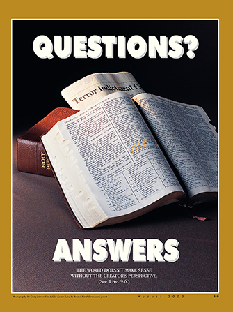 "A poster depicting a set of scriptures lying open next to a newspaper with current events, paired with the words ""Questions? Answers."""