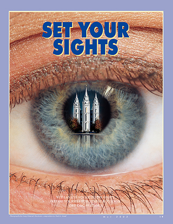 """A conceptual photograph of an eye with a temple reflected inside the pupil, paired with the words """"Set Your Sights."""""""