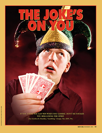 "An image of a young man in a joker hat holding playing cards, paired with the words ""The Joke's on You."""