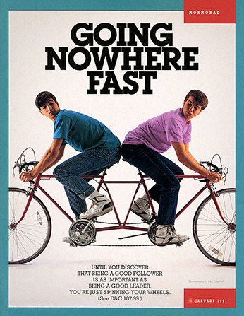 "A photograph of two young men riding a tandem bike with two front handle bars facing opposite directions, paired with the words ""Going Nowhere Fast."""