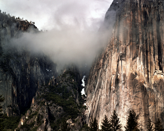 An image of cliffs and a low cloud in Yosemite National Park.