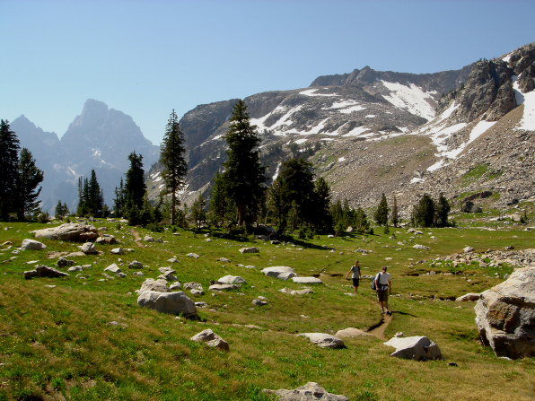 Two hikers on a trail in the Grand Teton National Park.