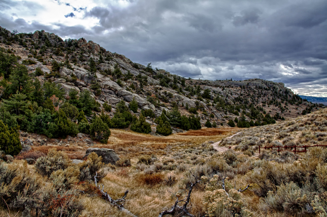 A view of Martin's Cove in Wyoming with dark clouds overhead.