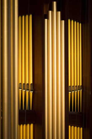 An image of a few tall, cylindrical pipes on the organ inside the Conference Center.