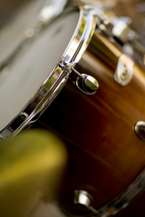 An image of brown drums used in a percussion group.