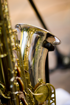 An image of a saxophone showing the keys and large pipe.