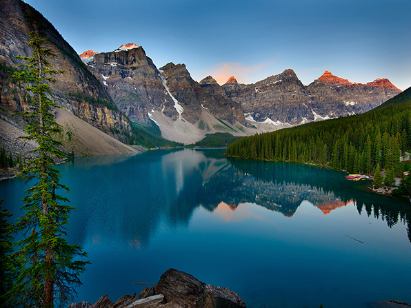 A view of Moraine Lake in Canada at sunrise.