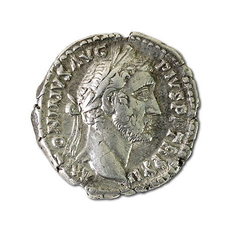 A detailed photograph of a small silver coin from the Roman era.