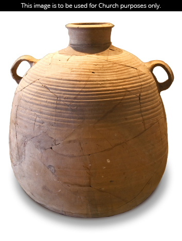 A large clay pot with two small handles and a small neck, set against a white background.