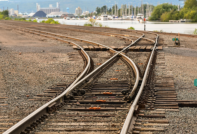 A switch separating a railroad track in several different directions in a rail yard.