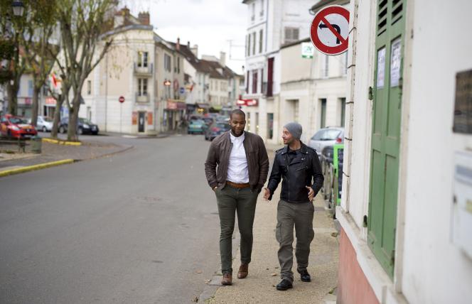 Cayo and Anthony walking around their neighborhood