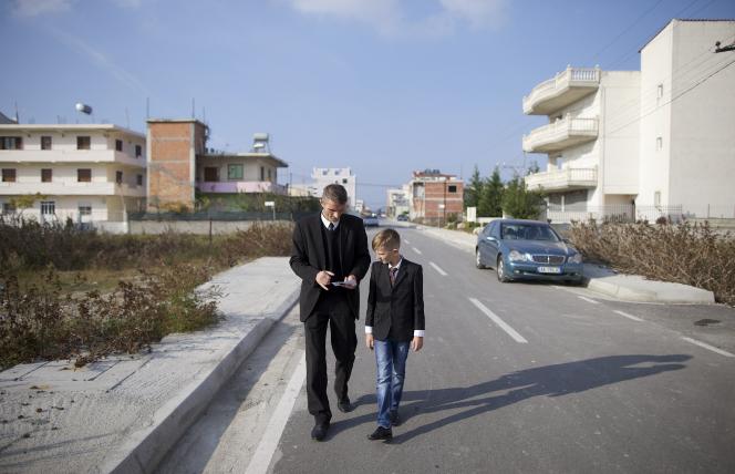 Ilir Dodaj walking with son