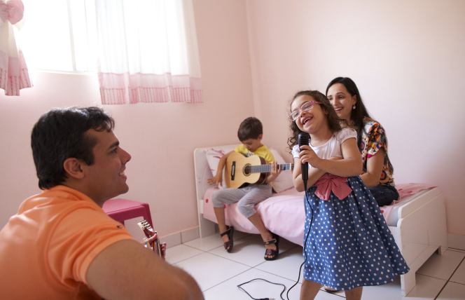 A family singing and playing music together.