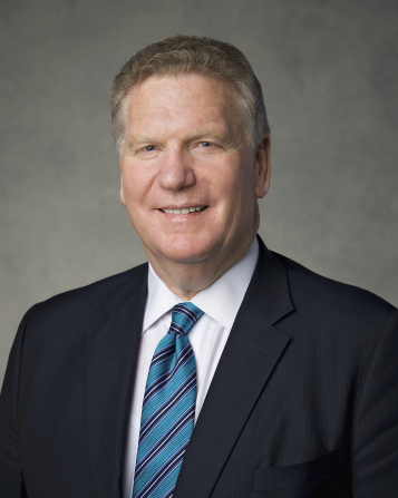 The official portrait of Elder Craig C. Christensen of the Presidency of the Seventy of The Church of Jesus Christ of Latter-day Saints, in a dark suit and a blue striped tie against a gray background.