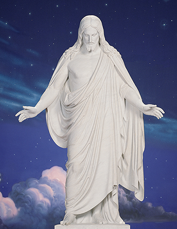 A statue of Jesus Christ against a painted backdrop resembling the night sky.