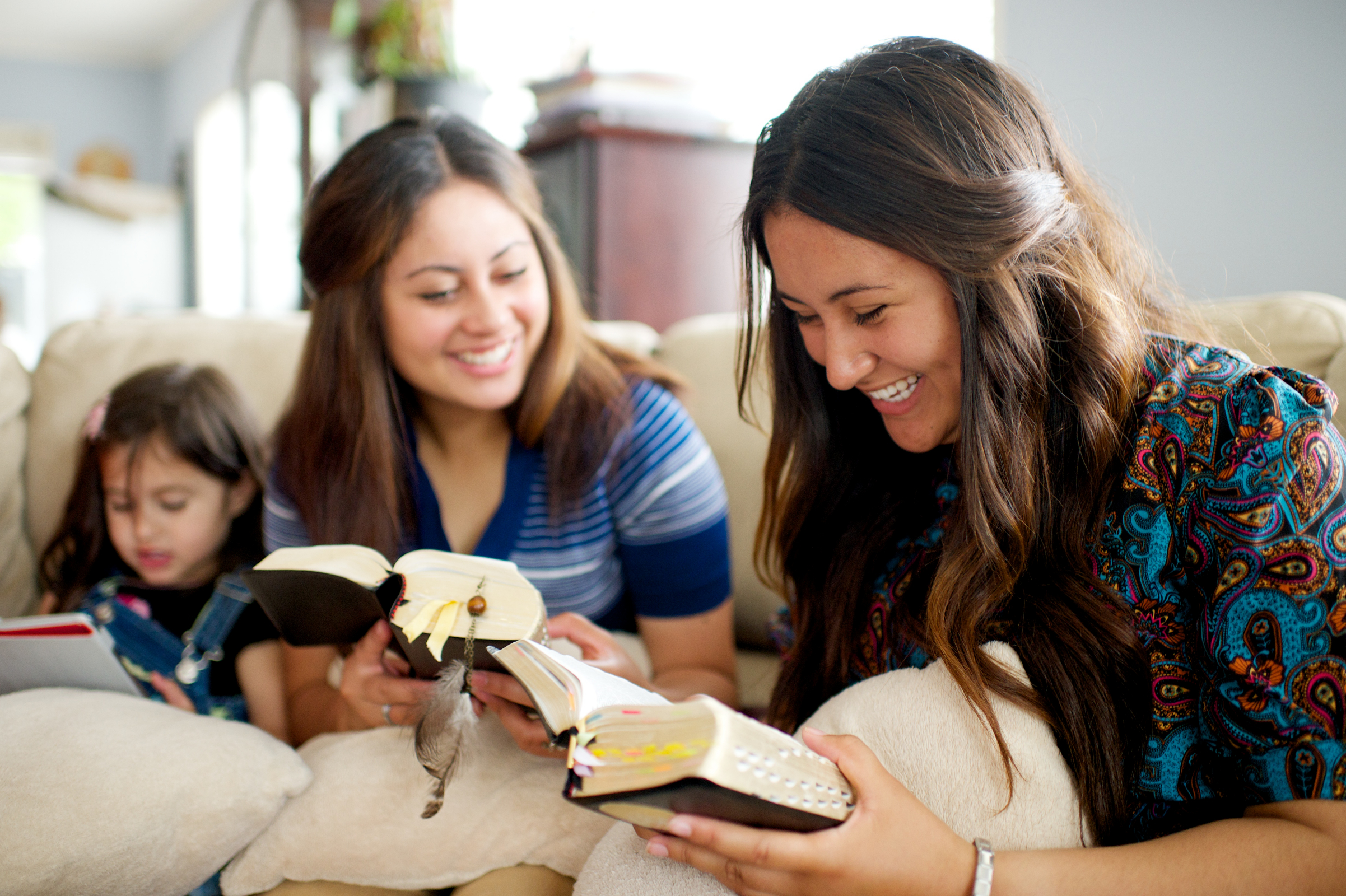 young women reading together