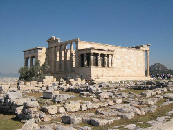A photograph of the Erechtheion on a sunny day.