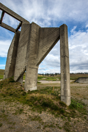 A concrete ruin on a hill in Chambers Bay in Washington, with clouds in the sky overhead.