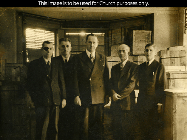 President Ezra Taft Benson standing with other men in suits during a visit to the European Mission in 1946.