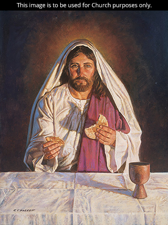 A painting by Robert T. Barrett of Jesus Christ sitting at a table and breaking bread as He introduces the sacrament.