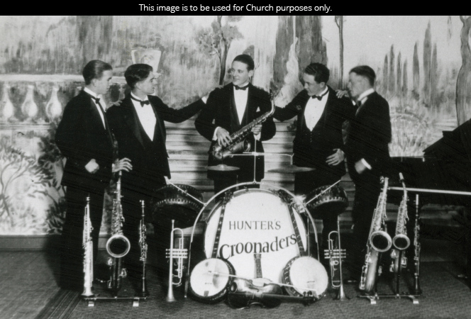 A black-and-white photograph of President Howard W. Hunter standing with the four members of his band, Hunter's Croonaders, all wearing tuxedos.