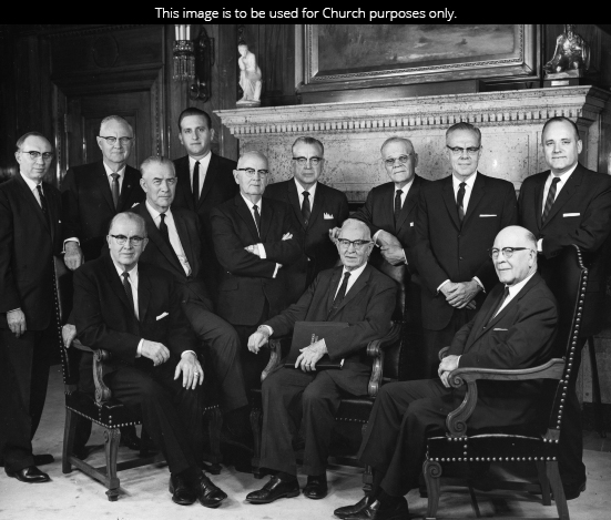 The Quorum of the Twelve Apostles in 1965. Seated left to right: Ezra Taft Benson, Mark E. Petersen, Joseph Fielding Smith, LeGrand Richards. Standing left to right: Gordon B. Hinckley, Delbert L. Stapley, Thomas S. Monson, Spencer W. Kimball, Harold B. Lee, Marion G. Romney, Richard L. Evans, and Howard W. Hunter.