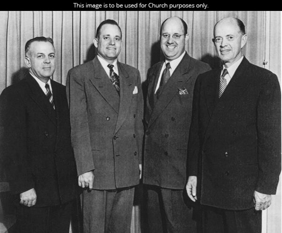 President Howard W. Hunter in 1950, standing with three other leaders of the Pasadena Stake, all dressed in white shirts, ties, and suits.