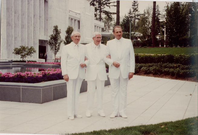 President Benson standing with his two counselors, President Monson and President Hinckley, all three in white clothes at the Portland Oregon Temple dedication.