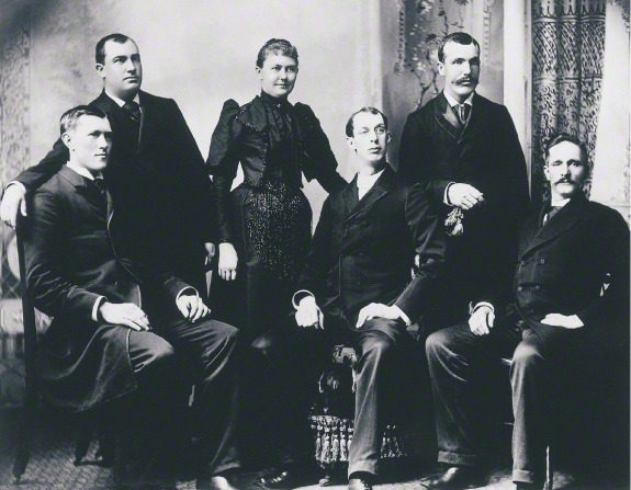 George Albert Smith sitting next to his wife, Lucy, who is standing near others at a missionary conference in Chattanooga, Tennessee, in 1893.