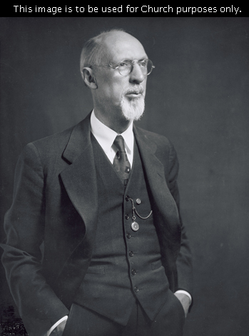 The prophet George Albert Smith in a black suit, with his hands in his pockets and a small pocket watch hanging from his vest.