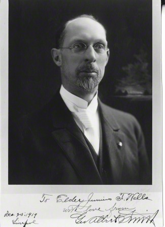 A portrait of the prophet George Albert Smith in oval glasses, a white shirt, and a black suit, dated December 20, 1919.