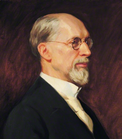 A portrait of the prophet George Albert Smith in a white shirt, a black suit, and glasses.