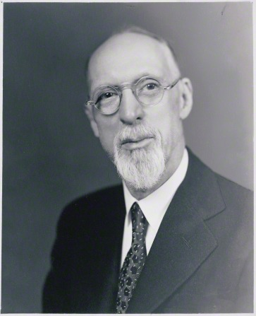 President George Albert Smith in a white shirt, dark suit, and spotted tie.