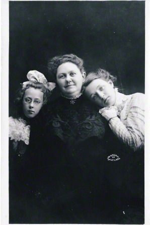George Albert Smith's wife, Lucy W. Smith, smiling between her two daughters, Edith (in glasses) and Emily (resting her head on her mother's shoulder).