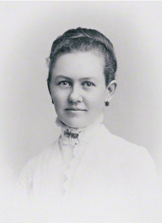 A portrait of George Albert Smith's wife, Lucy Smith, at age 19, in a white blouse and earrings, with her hair up.