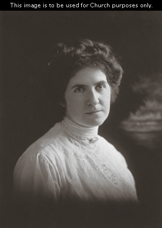 A portrait of Joseph Fielding Smith's second wife, Ethel Georgina Reynolds Smith, with dark hair, wearing a white blouse.