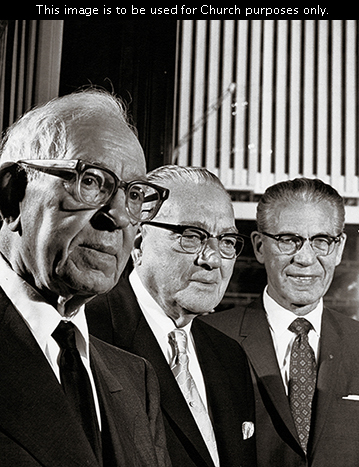 Joseph Fielding Smith standing with his two counselors in the First Presidency, Harold B. Lee and N. Eldon Tanner.