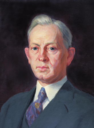 A portrait painting of the prophet Joseph Fielding Smith in a white shirt, dark suit, and purple tie.