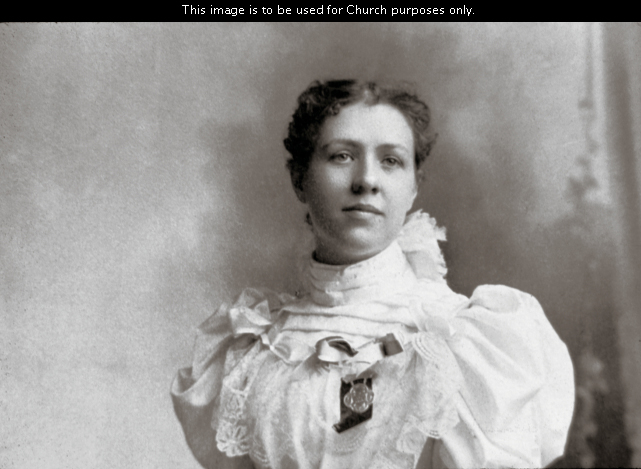 Louie Shurtliff Smith, President Joseph Fielding Smith's first wife, in a white dress with her hair pulled back.