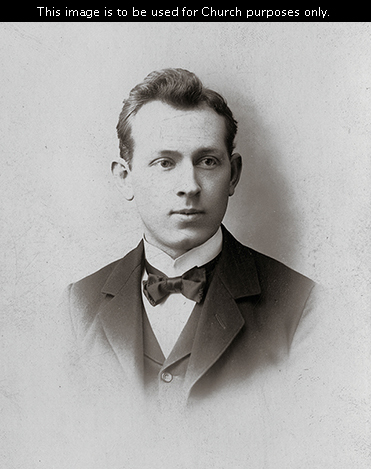 Elder Joseph Fielding Smith as a full-time missionary, wearing a white shirt, a bow tie, and a suit.