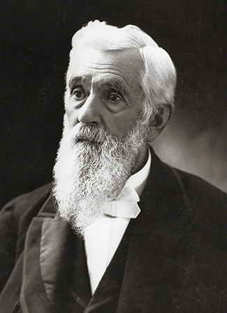 President Lorenzo Snow with white hair and a long beard, wearing a white shirt and dark suit.