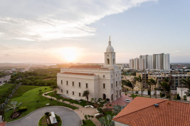 A sunset picture of the Barranquilla Colombia Temple and the surrounding area.