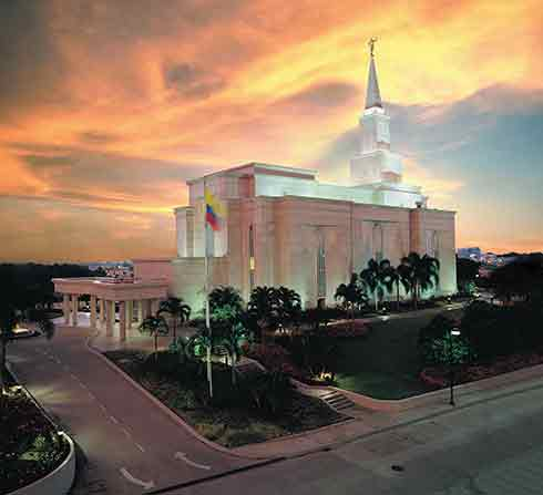 A view of the Guayaquil Ecuador Temple from across the street at sunset.