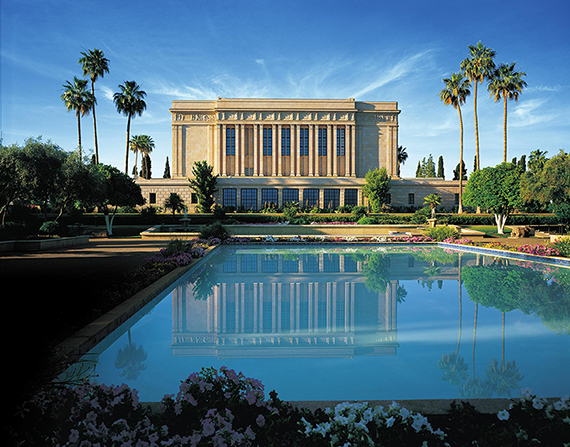 A view of the Mesa Arizona Temple and its reflection in a large pool on the grounds.